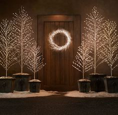 Starlit Tree - Snow from Restoration Hardware. These would create a pretty glow during your ceremony or reception