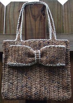 c948048a5acd Everyday Plarn Handbag with decorative bow . use as a book bag
