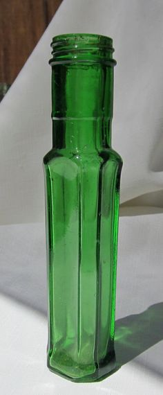 Antique, Green Colored Bottle (Green293).via Etsy.