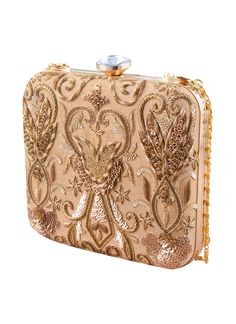 An ornate pattern of beads and sequins gives this square frame clutch bag a dazzling look. This gorgeous clutch from The Purple Sack is designed with a gold-tone frame and features a small square design, making it perfect for carrying from day to night. Handcrafted from raw silk, this gold-tone clutch includes a sparkling clasp closure and a small metal chain that offers versatile carrying options.