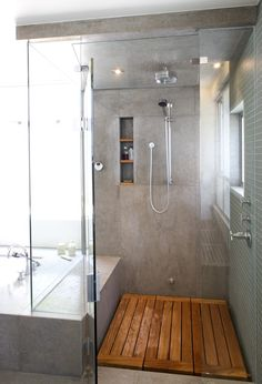 Love the wooden floor in this shower