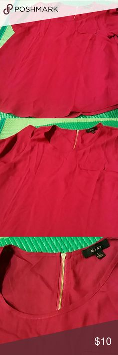 Flowy Top This is actual a burgundy color with a gold zipper in the back. It flows on you and looks very flattering. New never worn Mine Tops Blouses