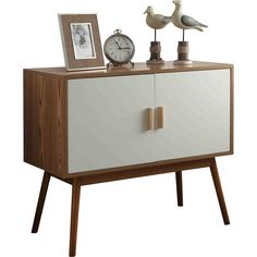 Lend a touch of contemporary appeal and essential storage space to any room in your home with this must-have accent cabinet. Minimalist and midcentury-inspired, it will elevate any room without disrupting your look. The clean-lined frame is supported by four flared legs and a neutral finish. The two cabinet doors feature bar pulls, and the cabinet features a middle shelf for ample space. Use it in your dining room to tuck away spare serveware, or set it in the entryway to corral out the door…