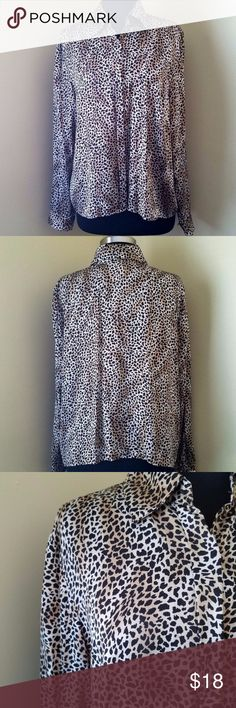 """Silk Animal Print Long-Sleeve Button Blouse, 16W Soft, sexy black and cream animal print, silk blouse with hidden front buttons.   100% silk   18"""" sleeve, 27"""" length, 48"""" bust. (All measurements are approximate.)  Size 16W by Rena Rowan. Tops Blouses"""