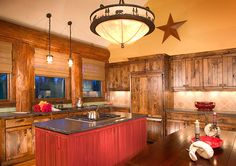 Red island for a pop of color in the log home decorated by Hunter & Co., Whitefish, Montana