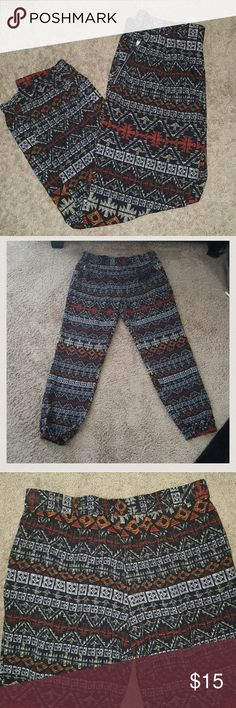 Jogger style pants printed pants very lightweight in on black with earthtones so cute and only worn once ...elastic waist and hem super comfortable ... silver zippers open and close pockets ...  28 inch inseam Spacegirlz Pants