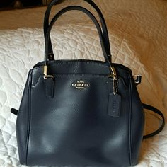 LOWERED PRICE !!! Coach Navy Blue Purse Excellent condition medium size Coach purse. Has a middle zipper compartment, outside front pocket, a side inside zipper pocket and an inside pocket. 2 compartments on each side of the middle zipper compartment.  Carried one time. No marks, no scratches. Coach Bags Shoulder Bags