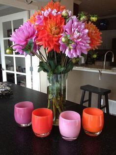 glassybaby votive holders with a matching floral arrangement