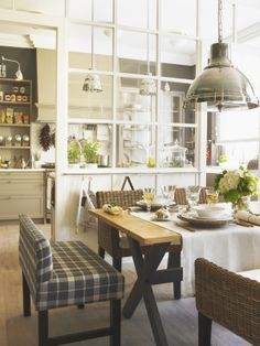 Love the interior window wall dividing this Kitchen//dining area.