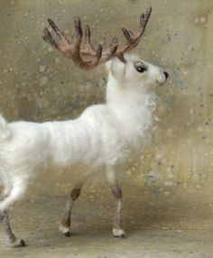 Needle Felted White Stag via Etsy.  love it, reminds me of Harry Potter's Patronus;p