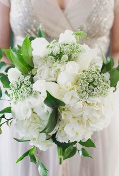 Wedding Bouquet Of Hydrangeas Roses Queen Annes Lace Italian Ruscus And Lemon Leaves