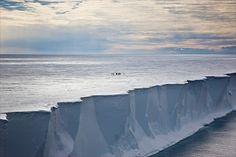 Sue Flood, photographer + :People standing on top of Ross Ice Shelf in Antarctica. This is Antarctica's largest ice shelf and is the size of France.  (from findout)