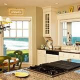 Large windows invite the beach into this  cottage  on Block Island, R.I. You can take in the sunrise while prepping breakfast, then enjoy the sunset over the Atlantic Ocean during dinner. The house is known as Clinton Cottage, named after former President Clinton's 1996 visit.  | HGTV FrontDoor