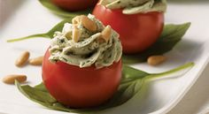 Cherry Tomatoes Filled with Creamy Pesto Cheese: This delicious and attractive appetizer is simple to prepare. You can make the creamy pesto filling ahead of time (keep it, covered, in the refrigerator for up to 2 days), but wait until shortly before serving to stuff the tomatoes.