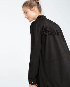 http://www.zara.com/pt/pt/mulher/jaquetas/camisa-larga-franjas-c269184p3016070.html
