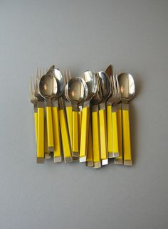 Vintage Crown Corning Flatware Mod Plastic Yellow / by luola