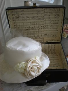 """""""Hope Chest"""" with sheet music (Hymns, Praise-n-Worship) or ads with current prices to look at someday."""