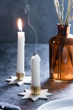 Candle blown out with a star candle holder base Concrete Candle Holders, Taper Candle Holders, Advent Candles, Diy Candles, Tin Can Lanterns, Bottle Chandelier, Star Candle, Candle Craft, Diy Bottle