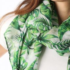 Ladies' White scarf with green leaf print, by Style Slice, embodies a bold tropical pattern. Elegant spring or summer shawl that can be personalised with a charm or a monogram. Suitable as a gift for anniversary, birthday or any day in which to tell the woman in your life, be it a Mum, Wife, Sister or Girlfriend, that she is special. #scarf #shawl #wrap #scarves #fashion #vintage #handmade #acessories #etsy #gift #paradise #palmtree #headwrap #ootd #tropical