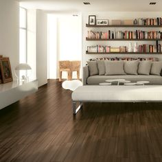 Not your grandmother's porcelain tile! This is the Eclipse Series in Brown from arizonatile.com. We think it is perfect for more than just living room floors.