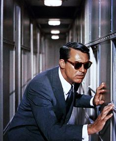 """ROGER: """"I know. I look vaguely familiar to you"""". Cary Grant in Alfred Hitchcock's """"NORTH BY NORTHWEST"""" (1959)."""