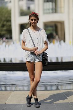 Taylor Hill nails the whole cool-without-even-trying thing in a holey tee and high-tops.