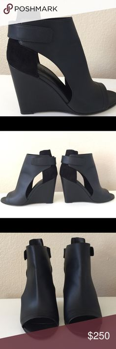 """Vince """"Katie"""" Leather Wedge Bootie Black """"This distinctive peep toe bootie is the wedged, modern version you've been dreaming of..."""" Timeless aesthetics meet modern sophistication in Vince's wearable essentials - always focusing on distinctive design, enduring style & uncompromising quality.   • Vince matte leather bootie  • 3 3/4"""" covered wedge heel • Covered vamp with cutout sides • Open toe • Grip strap at back of heel • Leather lining and sole • Suede upper back • """"Katia"""" is made in…"""