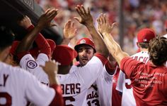 Matt Carpenter is welcomed to the dugout after scoring on a Jon Jay double in the third inning against the Pittsburgh Pirates at Busch Stadium on Friday, Sept. 6, 2013. Photo by Robert Cohen, rcohen@post-dispatch.com