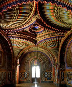 "The Peacock Room at Castello di Sammezzano in Reggello, Tuscany, Italy.  Atop a hill in a Tuscan oak tree grove, you'll find the abandoned Sammezzano Castle. The derelict building, built in 1605 with funds from Spanish nobility, features intricate Moorish designs and a breathtaking assortment of patterns and colors. Inside, the words ""Non Plus Ultra"" — meaning ""nothing further beyond"" in Latin — stands out above an archway."