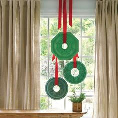Hang Ceiling Medallion Wreaths. Holiday decor that reflects architectural style! (Photo: Andrew McCaul)