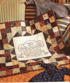 Small medallion quilt from book American Doll Quilts by Kathleen Tracy http://www.countrylanequilts.com/