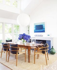 Neutral dining room with pops of cerulean blue