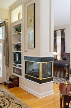 a little plain but I like the built in shelving with extra lighting at the top if need to build the wall out to accommodate inner components. 3 Sided Fireplace, Porch Fireplace, Fireplace Bookshelves, Fireplace Remodel, Fireplace Design, Joanna Gaines, Condo Living Room, Cottage, Home Remodeling