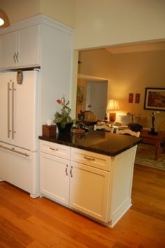 Good example of how to open up a small boxy kitchen.                  Normanton Remodel eclectic kitchen