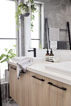 House call: Visit the plant-filled, Scandi inspired home of Haus of Cruze. White hexagon tiles in bathroom, indoor plants in bathroom, contemporary bathroom