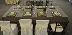 Black Chiavari Chair with Ivory Seat, White Chair Cover, Driftwood Linen, Square Rattan Plate Liner, Glass Oceana Square Dinner Plate, Glass Green Oceana Square Side Plate, 16oz Wine Glass, 12.5oz Wine Glass, 14.5oz Water Goblet, Oatmeal Napkin & Hudson Flatware | Chair-man Mills