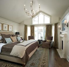 Candice Olson bedroom with sitting area and fireplace