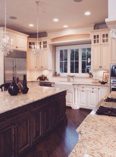 This kitchen isn't my idea of perfect, but I love the chandeliers over the island and the large window!