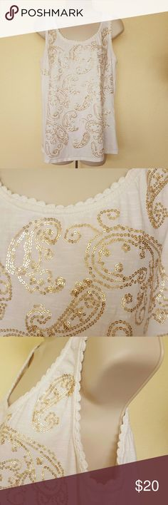 "Tommy Hilfiger tank top Tommy Hilfiger, size large,  cream colored tank top,  with gold rhinestones in a paisley pattern on front,  back has gathered detailing,  neck and arm holes are edged with crochet,  100% cotton,  19"" arm pit to arm pit,  25"" length, smoke free home,  excellent condition. Tommy Hilfiger Tops Tank Tops"