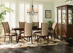 The best part about this Keira 7-piece dining set is that it seamlessly blends classic details with modern style. The table's double-pedestal base is reminiscent of 19th-century furniture. But the sleek, curvy chairs upholstered in tweed chenille provide a little contemporary flavor.