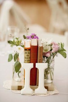 Books and roman numbers for table numbers #roman #Grecian #wedding