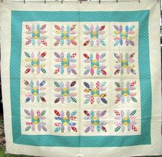1930's quilt. I gotta get me some of that green!!! it screams 30s!! So, I guess this green would be a good one for me to look into, too.