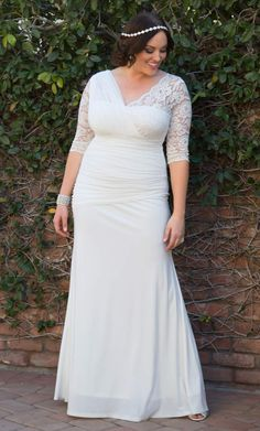 Feel like the gorgeous bride you are in our plus size Elegant Aisle Wedding Gown.  Soft mesh flows as you walk towards your happy ever after and a ruched drop waist flatters your killer cures.  Get THE dress at www.kiyonna.com.  #KiyonnaPlusYou  #MadeintheUSA