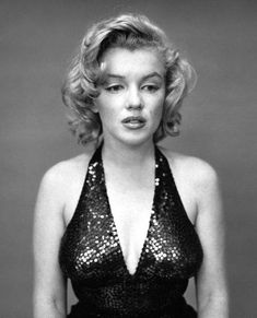 Marilyn Monroe by Yousuf Karsh. He portrays her sad vulnerability, a side of her that we know about but don't usually see.