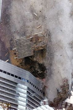 The south tower of New York's World Trade Center collapses Tuesday Sept. 11, 2001. In one of the most horrifying attacks ever against the United States, terrorists crashed two airliners into the World Trade Center in a deadly series of blows that brought down the twin 110-story towers. (AP Photo/Richard Drew) Photo: RICHARD DREW