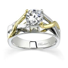 Two Tone Solitaire Engagement Ring - 7295LYW - Dramatic and unique, this two tone solitaire engagement ring  is sure to catch the eye of many admirers. Featuring a  yellow and white gold  crisscrossing cathedral shank, that rises to  form the prongs that hold the round diamond center securely in place. A bright polished mirror like gallery and a squared shank give this ring a contemporary edge.  Also available in two-tone yellow/white, all white and all yellow gold, 18k and Platinum.