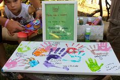 Artist party ' guest book ' / sign in idea! Get the kid's handprints on a canvas!