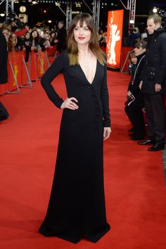Johnson shows some skin in a plunging black gown at the premiere of Fifty Shades of Grey at the Berlin Film Festival.   - ELLE.com