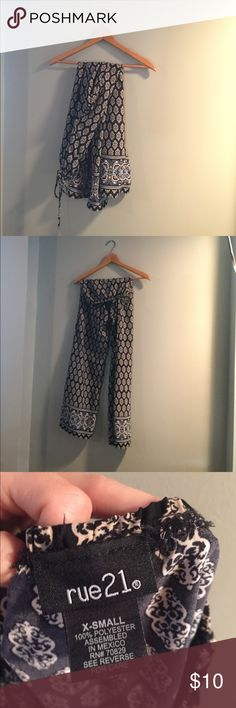 "Rue 21 Flowy Patterned Pants Lightweight pants perfect for summertime! Has elastic waist, with ""faux"" tie strings. Super cute. Lightly worn. Smoke free home. Rue 21 Pants"