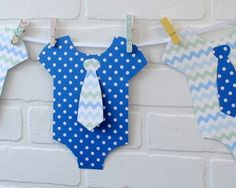 Close up of DIY baby onesie party banner